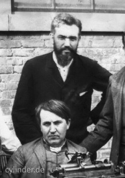 Fig. 1: The bearded Wangemann standing behind Edison